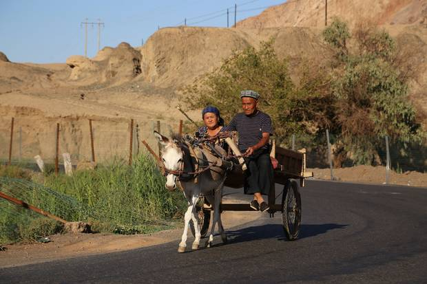 In the arid Turpan region, the largely Muslim Uyghurs live in oasis areas.