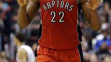 Toronto Raptors' Rudy Gay reacts after scoring during the second half of an NBA basketball game against the Philadelphia 76ers, Wednesday, Nov. 20, 2013, in Philadelphia. Toronto won 108-98. (AP Photo/Matt Slocum) (Matt Slocum/The Associated Press)