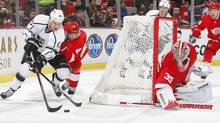 Kyle Clifford of the Los Angeles Kings attempts a wrap around as Jakub Kindl of the Detroit Red Wings defends. (Dave Sandford/2011 Getty Images)