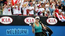 Eugenie Bouchard of Canada walks off the court after her win over Virginie Razzano of France during their second round match at the Australian Open tennis championship in Melbourne, Australia, Wednesday, Jan. 15, 2014. (Andrew Brownbill/AP Photo)