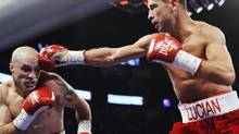 Lucian Bute from Montreal, Que., right, lands a blow to the head of Jesse Brinkley, from the United States, during their IBF super middleweight title bout in Montreal on Friday October 15, 2010. (Graham Hughes/THE CANADIAN PRESS)