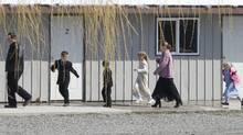 Members of the polygamous community of Bountiful gather for church Sunday, April 20, 2008 near Creston, B.C. (Jonathan Hayward/The Canadian Press/Jonathan Hayward/The Canadian Press)