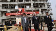 Natural Resources Minister Joe Oliver visits a construction site in the Tianjin Economic Development Area in Tianjin, China, Monday, Nov. 7, 2011. (Marketwire photo/MARKETWIRE photo)