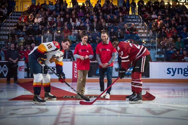Rich Peverly drops the puck at a PEVS Protects game the Erie Otters and the Guelph Storm.