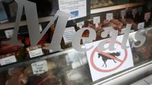 A 'no horsemeat' sign is exhibited alongside meats in the window of Bates Butchers at Market Harborough, central England, February 20, 2013. (DARREN STAPLES/REUTERS)