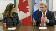 Prime Minister Stephen Harper speaks with Melpa Kamateros, executive director of Shield of Athena in Montreal, Friday, March 16, 2012, prior to announcing support by the Canadian government to address family violence and violence against women. (Graham Hughes/THE CANADIAN PRESS)