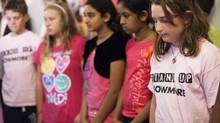 Alison Barrett joins her schoolmates and students across the country as she takes part in a moment of silence to remember bullying victim Amanda Todd at Bowmore Road Junior and Senior Public School in Toronto on Friday, October 19, 2012. (Michelle Siu/The Globe and Mail)