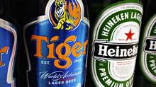 Heineken is paying $4.2-billion to F&N for control of Tiger Beer and 24 Asian breweries. (TIM CHONG/REUTERS)