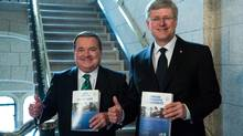Finance Minister Jim Flaherty and Prime Minister Stephen Harper enter the House of Commons to table the budget on Parliament Hill in Ottawa on Thursday March 21, 2013. (Patrick Doyle/THE CANADIAN PRESS)
