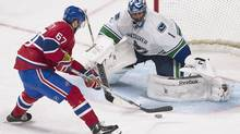 Vancouver Canucks' goaltender Roberto Luongo stops a penalty shot by Montreal Canadiens' Max Pacioretty during second period NHL hockey action in Montreal, Thursday, February 6, 2014. (Graham Hughes/THE CANADIAN PRESS)