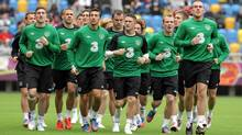 Ireland's team runs on the pitch during a training session at Gdynia municipal stadium June 5, 2012. (Reuters)