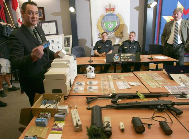 Sgt Larry Levasseur, left to right, Winnipeg Police Superintendent Gordon Schumacher, Inspector Thomas Legge and Sgt. Mitch McCormick appear at a news conference in Winnipeg in 2007 as part of lengthy investigation dubbed Project Kite, which seized the antique Koechert Diamond Pearl.
