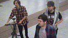 Three men, one of them wheeling a bicycle, walked into the Bathurst station May 1 at around 1:15 a.m., police said, The trio headed down to the westbound platform, and shortly before a train pulled in the bicycle was thrown on to the tracks, close to the electrically charged third rail. (Toronto Police Service)