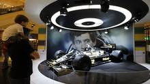 Visitors look at the Ayrton Senna John Player Special F1 car during an exhibition to mark the 20th anniversary of the death of Brazilian triple Formula One champion Ayrton Senna in Sao Paulo April 10, 2014. (PAULO WHITAKER/REUTERS)