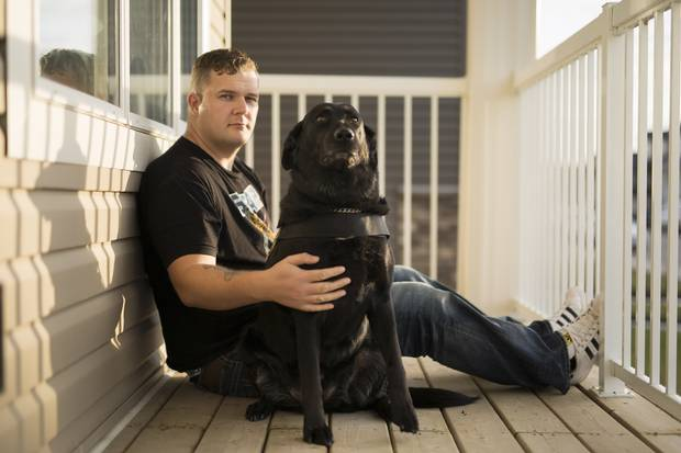 Joe Rustenburg with his service dog Vixin. Mr. Rustenburg served two tours in Afghanistan and is vocal about his struggles with mental-health.