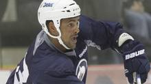 Winnipeg Jets Dustin Byfuglien (33) practices at the 2011 training camp in Winnipeg. The Winnipeg Jets had their first practice in Winnipeg Saturday, September 17, 2011. THE CANADIAN PRESS/John Woods (John Woods)
