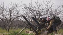 Free Syrian Army fighters set up mortars pointing toward Nairab military airport and the international airport, which are controlled by forces loyal to Syrian President Bashar al-Assad in Aleppo. (MUZAFFAR SALMAN/REUTERS)