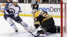 Winnipeg Jets' Evander Kane (9) scores on Boston Bruins goalie Tim Thomas in the first period of an NHL game in Boston, Saturday, Nov. 26, 2011. (Michael Dwyer/AP)