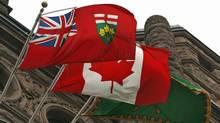 The Ontario and Canadian flags fly over Queen's Park in Toronto. (Deborah Baic/Deborah Baic/The Globe and Mail)