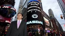 Yong Hui Li, chairman and CEO of AutoChina, in New York's Times Square. The company's shares began trading on Nasdaq in in October, 2009. (Zef Nikolla)