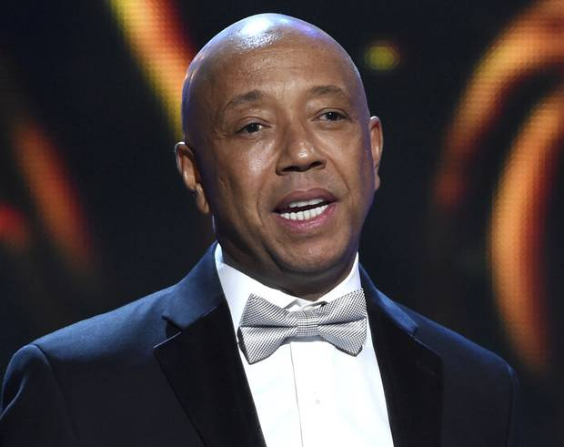 In this Feb. 6, 2015, file photo, hip-hop mogul Russell Simmons presents the Vanguard Award on stage at the 46th NAACP Image Awards in Pasadena, Calif. Simmons announced on Nov. 30, 2017, he would be stepping down from companies he founded following a new allegation of sexual misconduct.