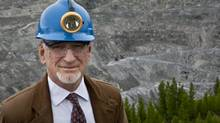 """Bernard Coulombe, CEO of Mine Jeffrey Asbestos Mine, poses near his mine's open pit in the town of Asbestos, Quebec, on June 30, 2011. Coulombe said his company has """"taken all necessary measures"""" to ensure their product is safe. (Francis Vachon For The Globe and Mail)"""