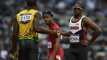 Canada's Aaron Brown (R) shakes hands with Jamaica's Usain Bolt after their men's 200m semi-final during the London 2012 Olympic Games at the Olympic Stadium August 8, 2012. REUTERS/Dylan Martinez (BRITAIN - Tags: OLYMPICS SPORT ATHLETICS) (DYLAN MARTINEZ/REUTERS)