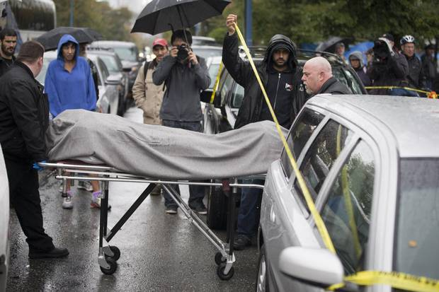 The body of Joerg Yogi Brylla, also known as Bunny George, is taken away from Vancouver's Oppenheimer Park after he was found dead on Oct. 15, 2014.