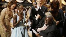 Director and producer Steve McQueen (R) celebrates after accepting the Oscar for best picture with Lupita Nyong'o (L) at the 86th Academy Awards in Hollywood, California March 2, 2014. (LUCY NICHOLSON/REUTERS)