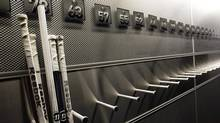 A nearly-empty hockey stick rack in the Buffalo Sabres locker room is shown at the First Niagara Center, home of the Buffalo Sabres, in Buffalo, N.Y., Tuesday, Sept. 25, 2012. (David Duprey/AP)