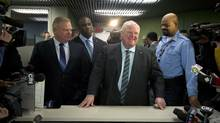 Mayor Rob Ford arrives at the elections office at City Hall to file papers to officially enter the 2014 mayoral race in Toronto, Ontario, Thursday January 2, 2014.