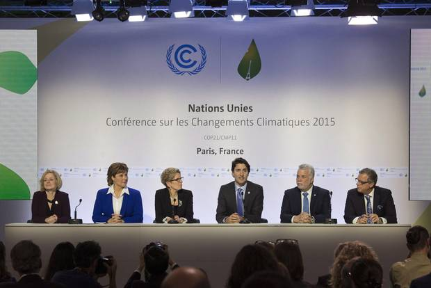 Canadian Prime Minister Justin Trudeau speaks during a news conference with Albeta Premier Rachel Notley (left), B.C. Premier Christy Clark , Ontario Premier Kathleen Wynne , Quebec Premier Philippe Couillard and Saskatchewan Premier Brad Wall at the United Nations climate change summit Monday, November 30, 2015 in Le Bourget, France.