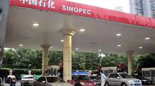 Customers fill up at a Sinopec gas station in Shanghai, China. (AP)