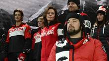 Athletes pose wearing the new Canadian Olympic and Paralympic team collection made by Hudson's Bay that will outfit Canada's athletes at the upcoming Sochi 2014 Olympic and Paralympic winter Games, in Toronto on Wednesday, Oct. 30, 2013. (Fred Lum/The Globe and Mail)