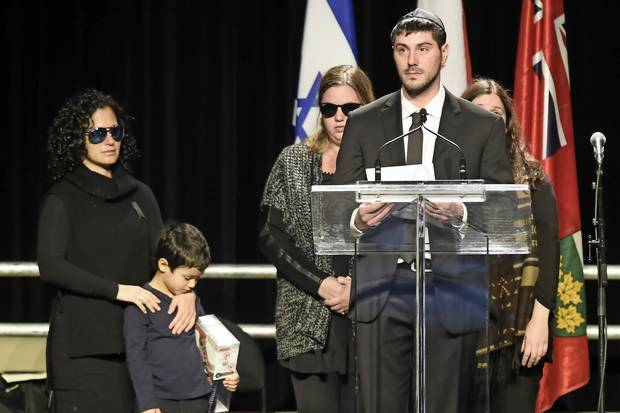 Jonathon Sherman speaks during a memorial service for his parents Barry and Honey Sherman as family members look on in Mississauga, Ont. on Dec. 21, 2017.