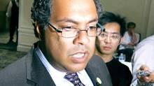 Calgary Mayor Naheed Nenshi speaks to reporters in Calgary on Sept. 12, 2013. (BILL GRAVELAND/THE CANADIAN PRESS)