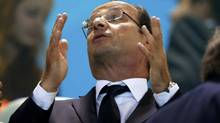 France's President Francois Hollande sits in the stands during the evening session of the swimming events at the London 2012 Olympic Games at the Aquatics Centre July 30, 2012. (MICHAEL DALDER/REUTERS)