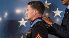 "President Barack Obama places a Medal of Honor on retired Cpl. William ""Kyle"" Carpenter. Carpenter shielded a fellow Marine from a grenade with his body while guarding a patrol base in Helmand Province, Afghanistan in 2010, sustaining multiple severe wounds, including the loss of his right eye. (Gabriella Demczuk/The New York Times) (GABRIELLA DEMCZUK/NYT)"