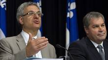 Quebec Justice Minister Jean-Marc Fournier, left, gestures as he announces the province is launching a $60 billion lawsuit against tobacco manufacturers as Quebec Health Minister Yves Bolduc looks on during a press conference on Friday, June 8, 2012. (Clement Allard/THE CANADIAN PRESS)