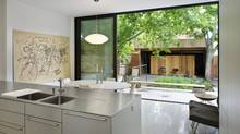 Home of Martin Kohn and Dufflet Rosenberg. Kitchen looking out west opening to modified garage. (Photo by Tom Arban)