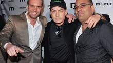 Muzik owner Zlatko Starkovski, left, shown with actor Charlie Sheen and comedian Russell Peters, currently pays the city a maximum of $10,000 a month, with possible additional payments, for his club's lease at Exhibition Place. (George Pimentel)