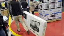 A shopper buys a TV at a Best Buy store in Mississauga, Ont. (J.P. MOCZULSKI For The Globe and Mail)