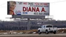 A Calgary real estate agent has stirred up controversy with a suggestive billboard. The Re/Max advertisement, shown in Calgary, Thurs., Feb. 7, 2013, features a closeup photograph of Diana Arvatescu and the invitation: 'Let me take you home. It's gorgeous inside.' (Jeff McIntosh/THE CANADIAN PRESS)