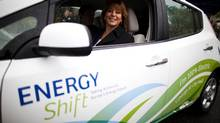 Surrey Mayor Dianne Watts takes a100-per-cent electric Nissan Leaf for a test drive after leaving a charging station at City Hall in Surrey last October. (Rafal Gerszak for The Globe and Mail)