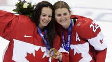 Team Canada's goalie Shannon Szabados and forward Hayley Wickenheiser celebrated after winning the gold medal women's hockey February 20, 2014 at the Sochi Winter Olympics. (John Lehmann/The Globe and Mail)