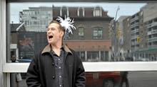 Comedian Scott Thompson wears a feather tiara after suggesting Drag Day as his big idea for Toronto, on Queen Street West, Friday April 29, 2011 (J.P. Moczulski for The Globe and Mail)