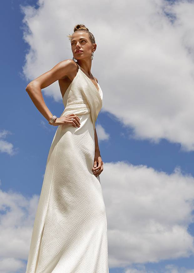 9b751a42b21 An ivory Elizabeth Fillmore gown in a textured textile finds inspiration in  a more ancient Grecian