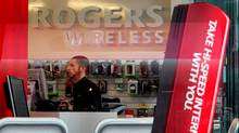 An employee works inside a Rogers Wireless retail store in Vancouver, B.C.. (DARRYL DYCK/THE CANADIAN PRESS)