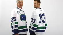 Original Canucks captain Orland Kurtenbach and current Canuck Henrik Sedin are pictured wearing the new, third sweater for the 2010-11 season. (Photo provided by the Canucks)