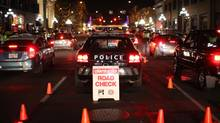 Victoria Police set up an impaired-driving checkstop on Yates Street downtown. (Chad Hipolito for The Globe and Mail)
